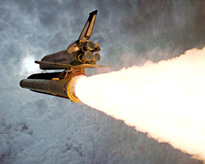 Space Shuttle and the Ideal rocket equation